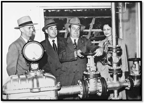 Opening the valve to Trussville's Natural Gas Facility in 1947.  Shown (Left to right) are Councilman John Yarbrough, Mayor Horace Norrell, Councilman George Glenn, and Councilwoman Mary Lou Farley.